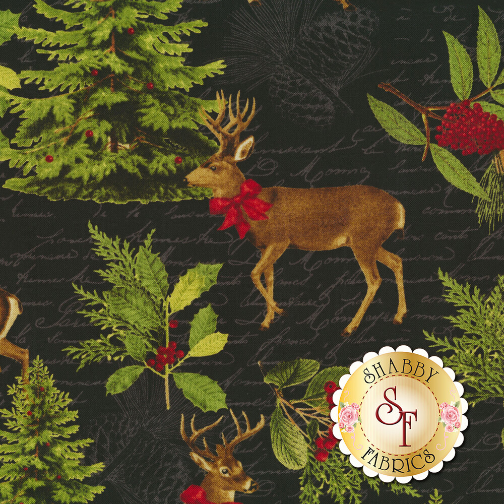 Deer with Christmas tree and holly on black fabric with tonal script   Shabby Fabrics