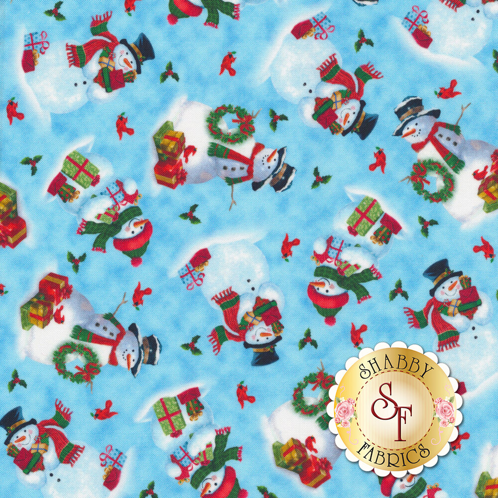 Tossed snowmen and red cardinals on a light blue mottled background | Shabby Fabrics