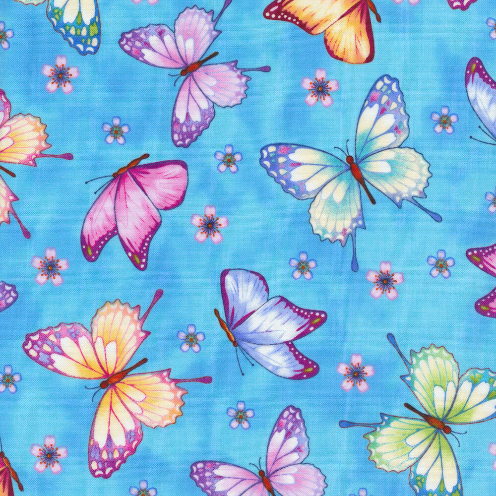 Tossed colorful butterflies on a mottled blue background | Shabby Fabrics