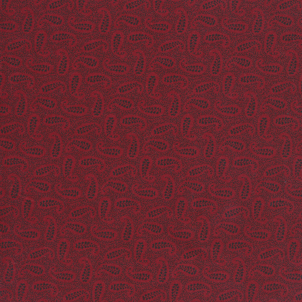 Tossed red and black paisleys on a textured red background | Shabby Fabrics