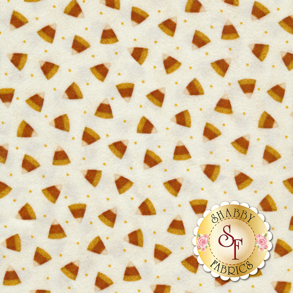 Tossed candy corn on a white background | Shabby Fabrics