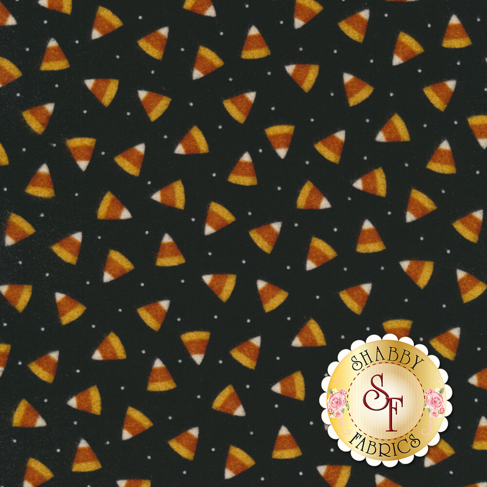 Tossed candy corns on a black background | Shabby Fabrics