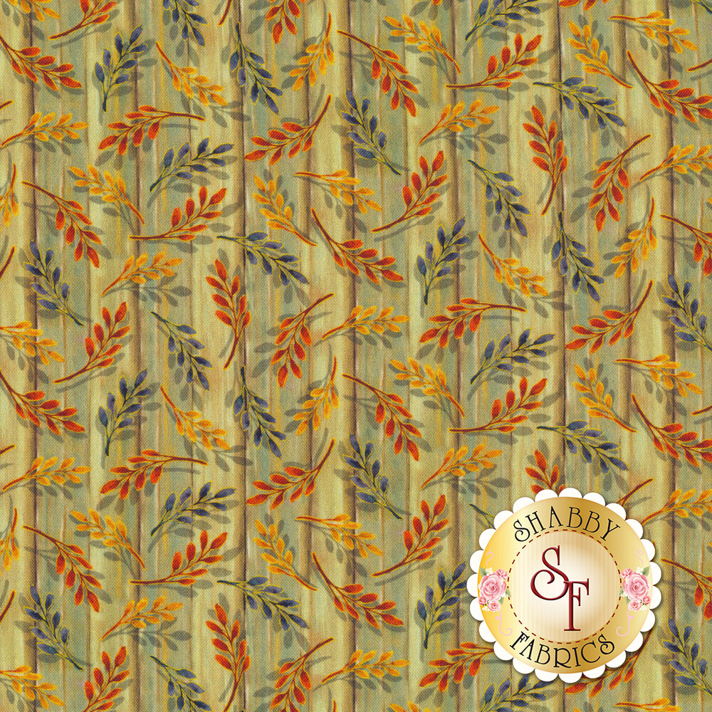 Tossed autumn leaves on a wood textured green background | Shabby Fabrics