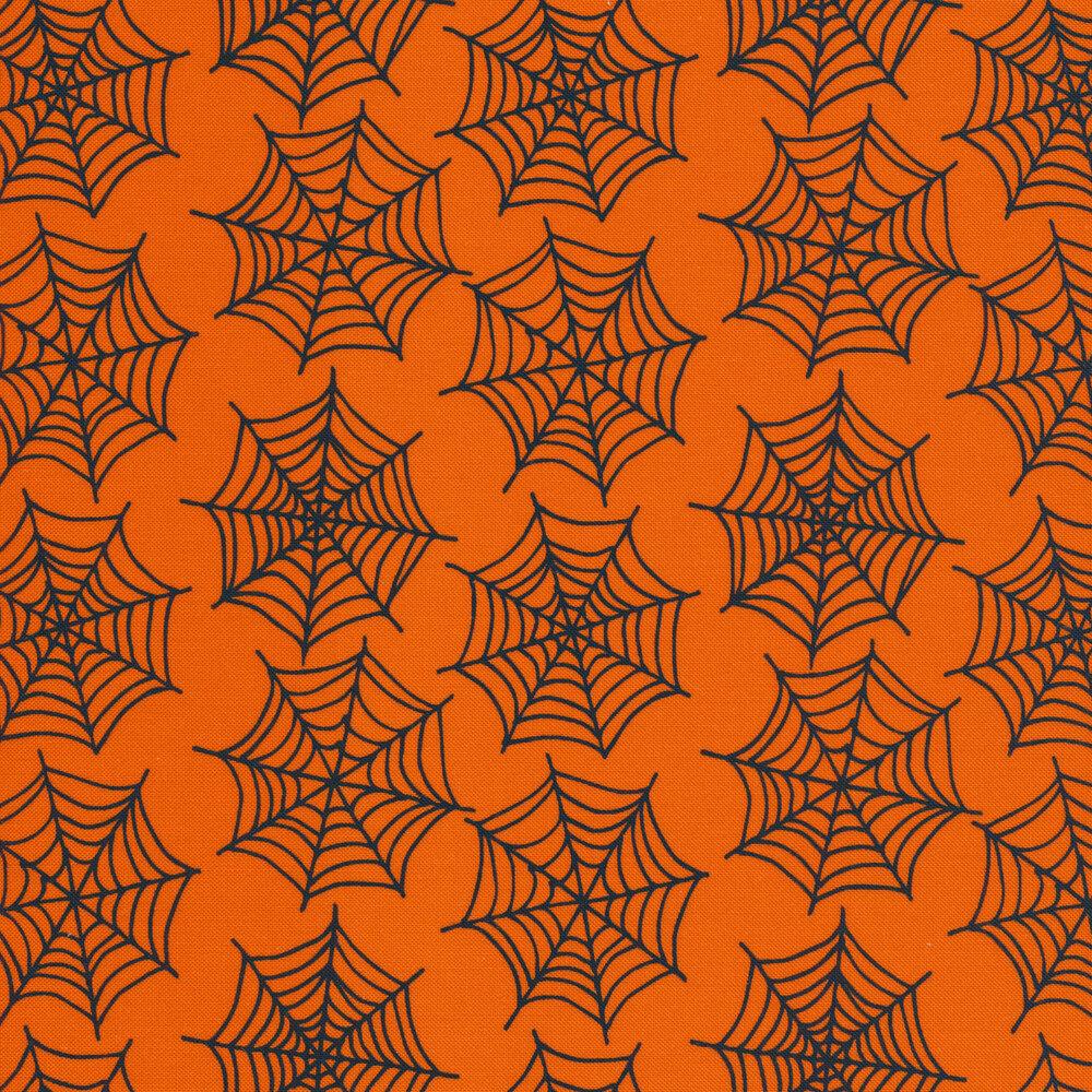 Spiderwebs on an orange background