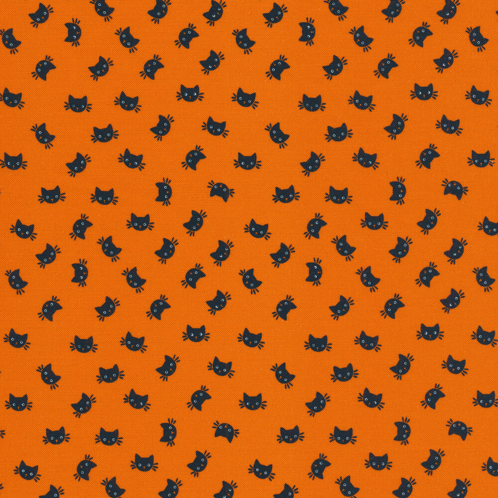 Tossed black cat heads on an orange background