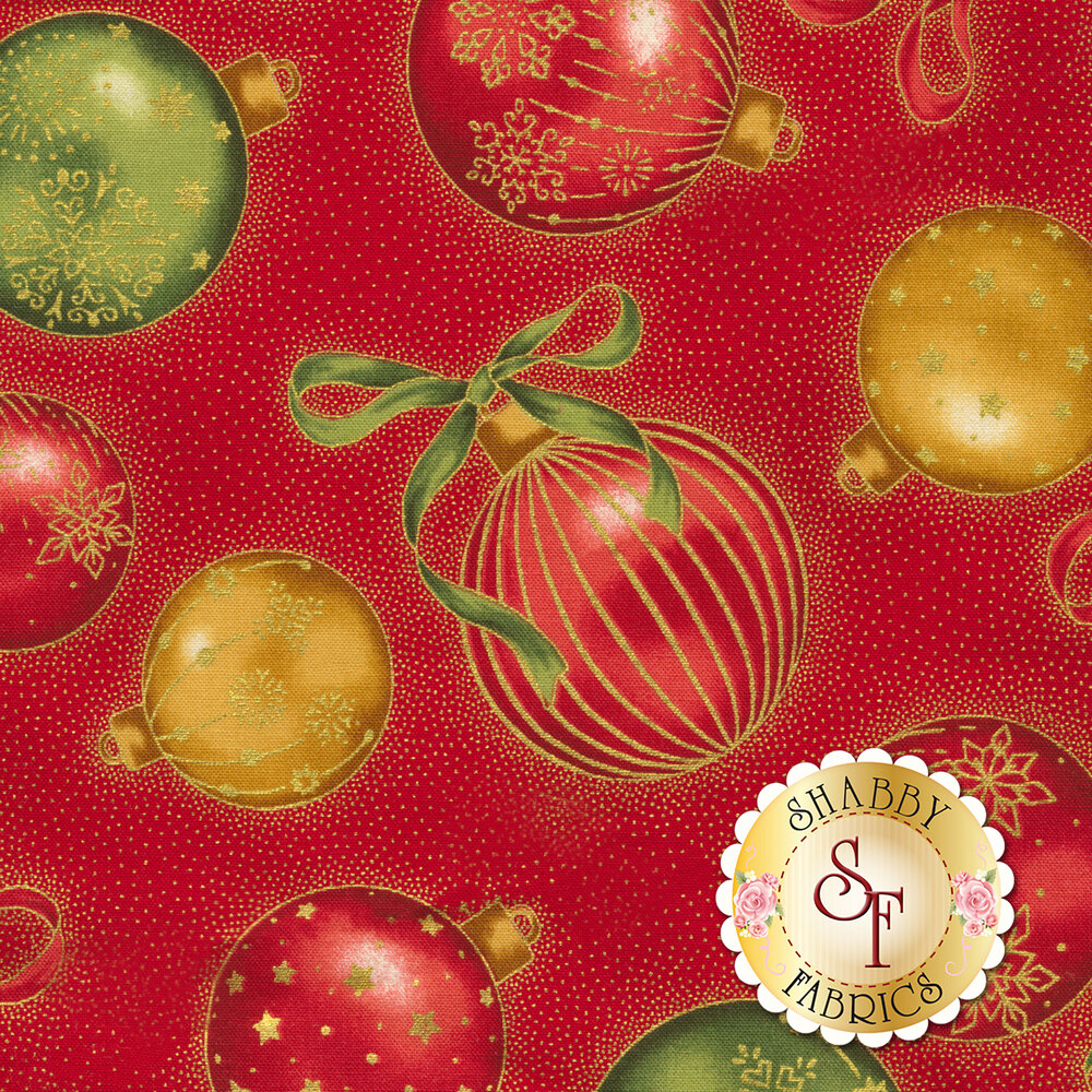 Red, gold, and green ornaments tossed on red | Shabby Fabrics