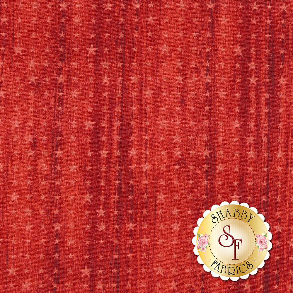 A tonal red fabric with a wood grain background and different sized stars all over | Shabby Fabrics