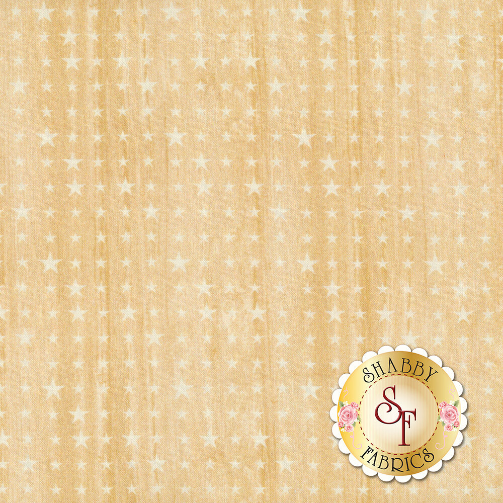 A beige fabric with a wood grain background and different sized stars all over | Shabby Fabrics