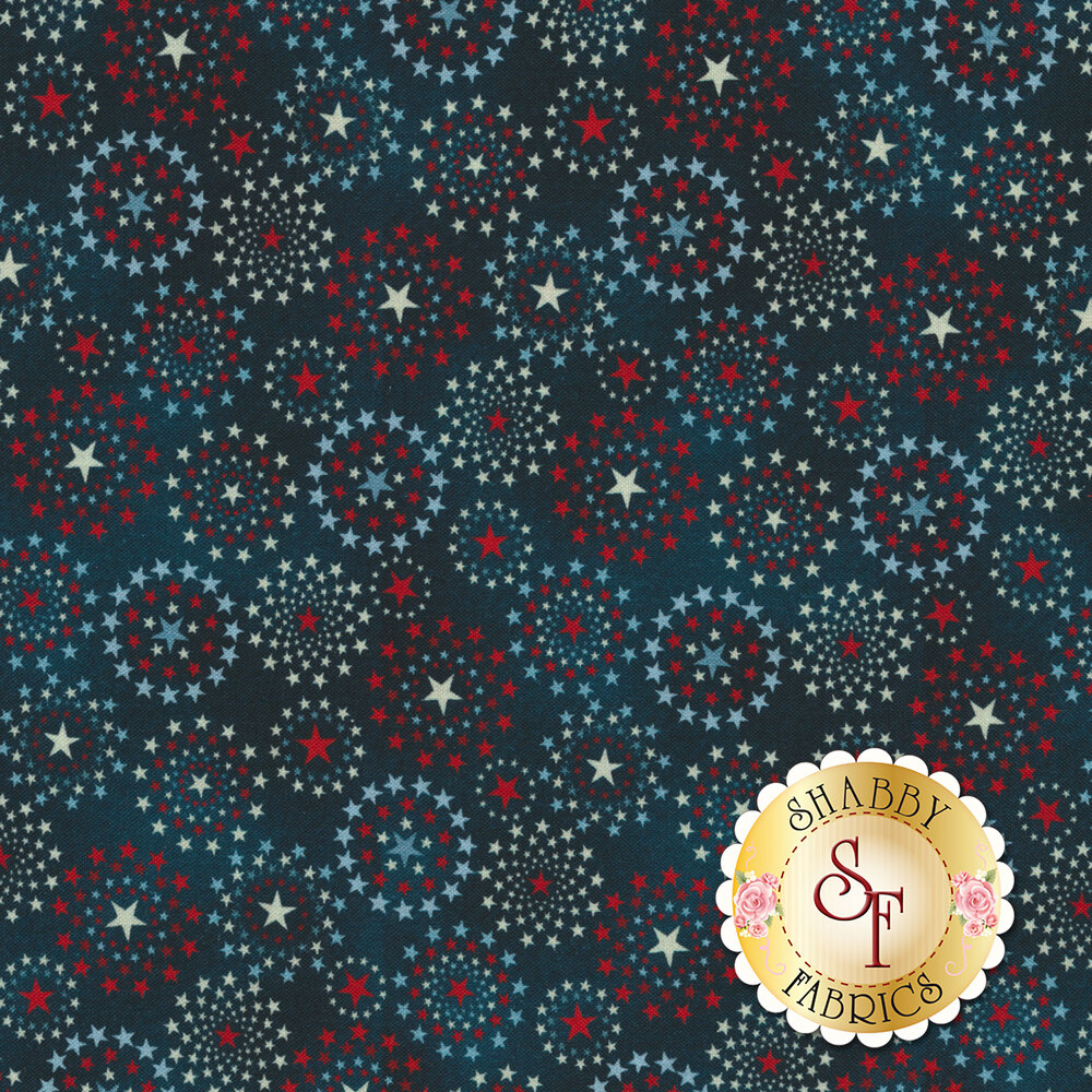 Patriotic fabric with stars in the shape of bursting fireworks on a blue background   Shabby Fabrics