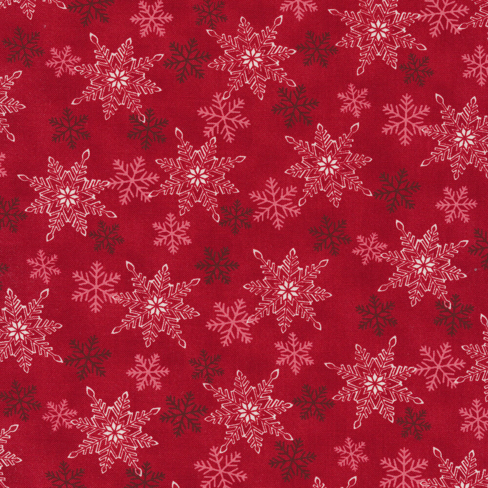 White and dark red snowflakes all over a red background