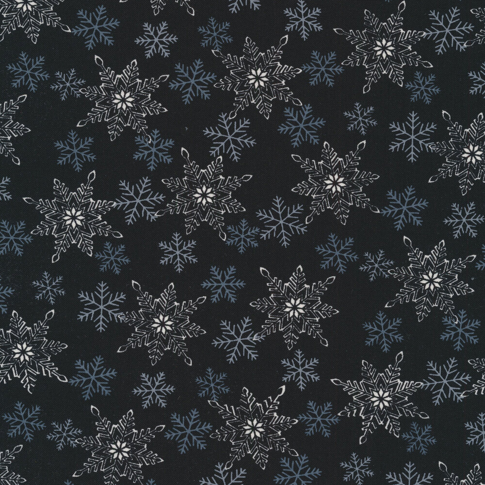 White and gray snowflakes all over a black background