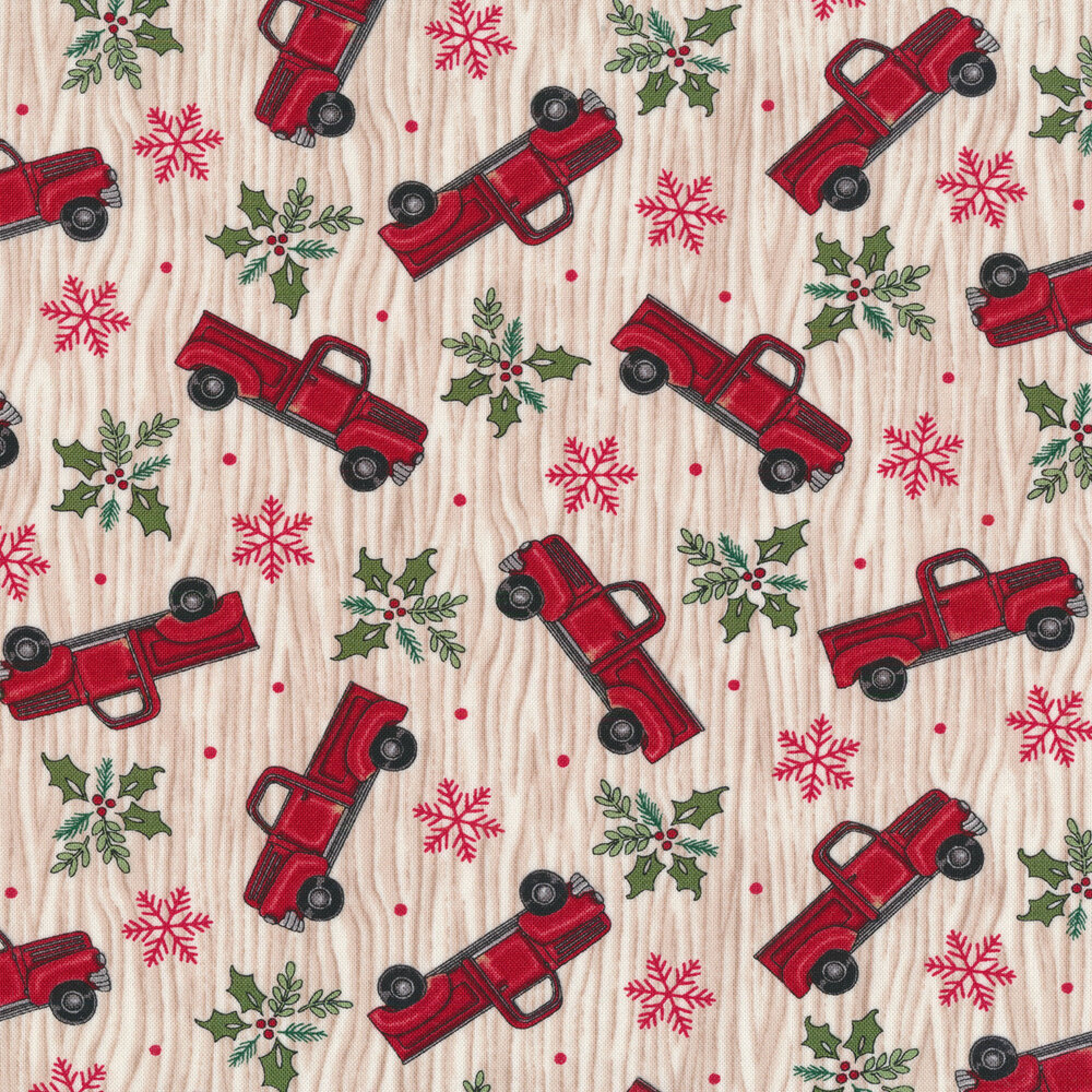 Tossed vintage trucks, snowflakes, and holly on a tan wood grain background