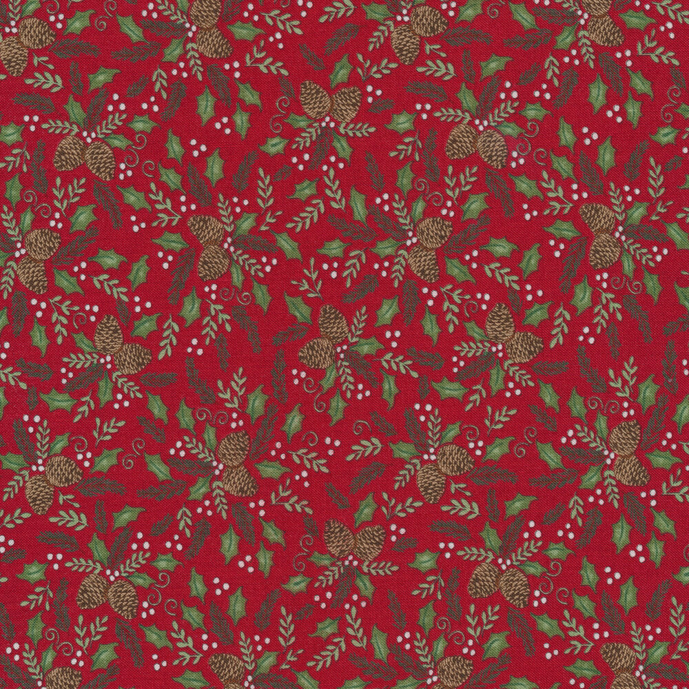 Tossed pine cones and holly berries on a red background