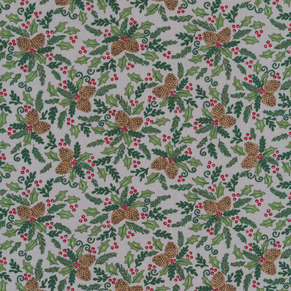 Tossed pine cones and holly berries on a grey background