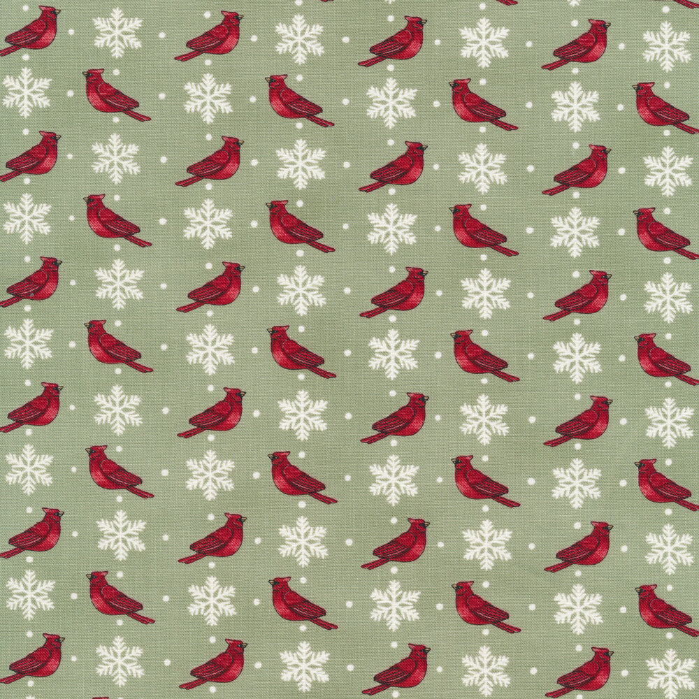 Red cardinals and white snowflakes on a green background
