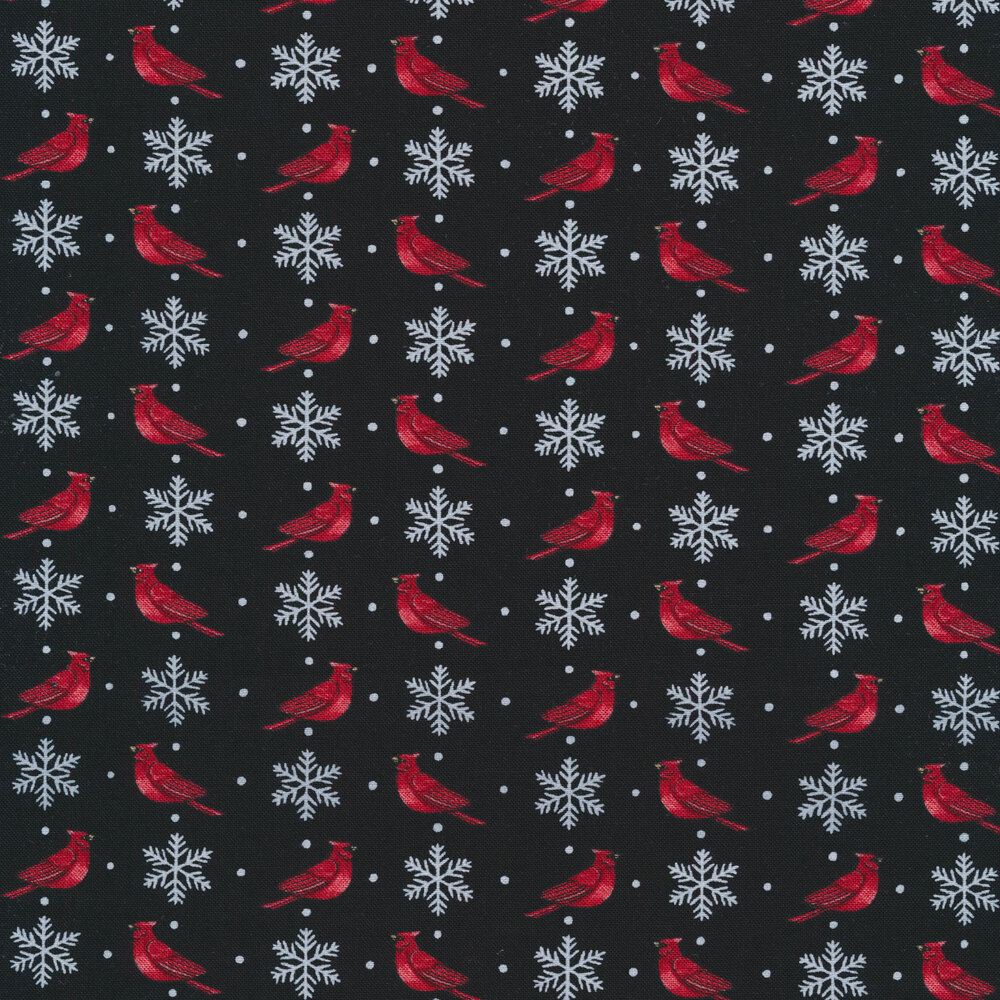Red cardinals and white snowflakes on a black background