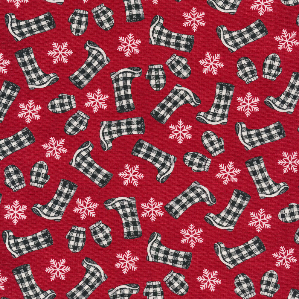 Tossed black and white plaid boots and mittens with snowflakes on a red background