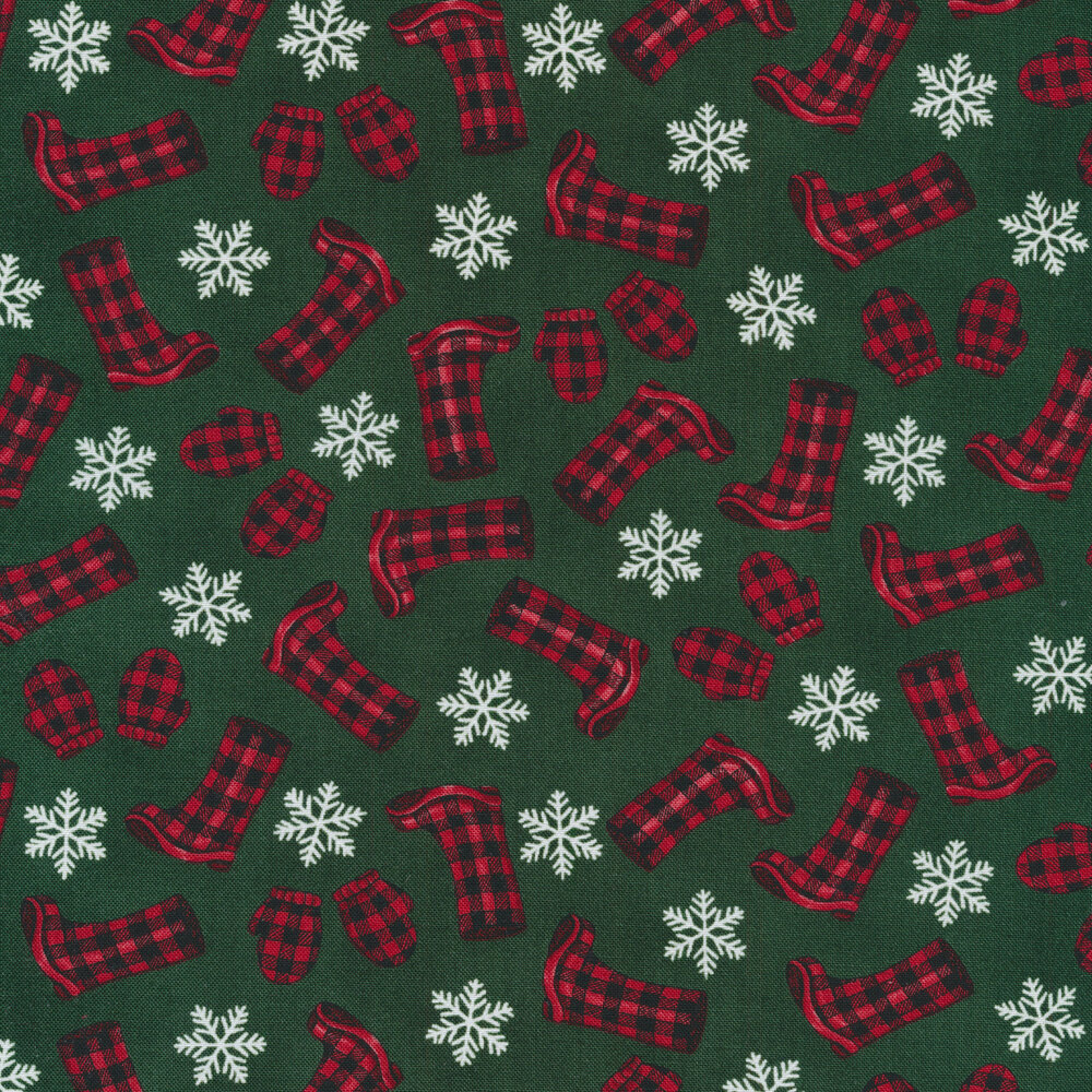 Tossed red and black plaid boots and mittens with white snowflakes on a green background