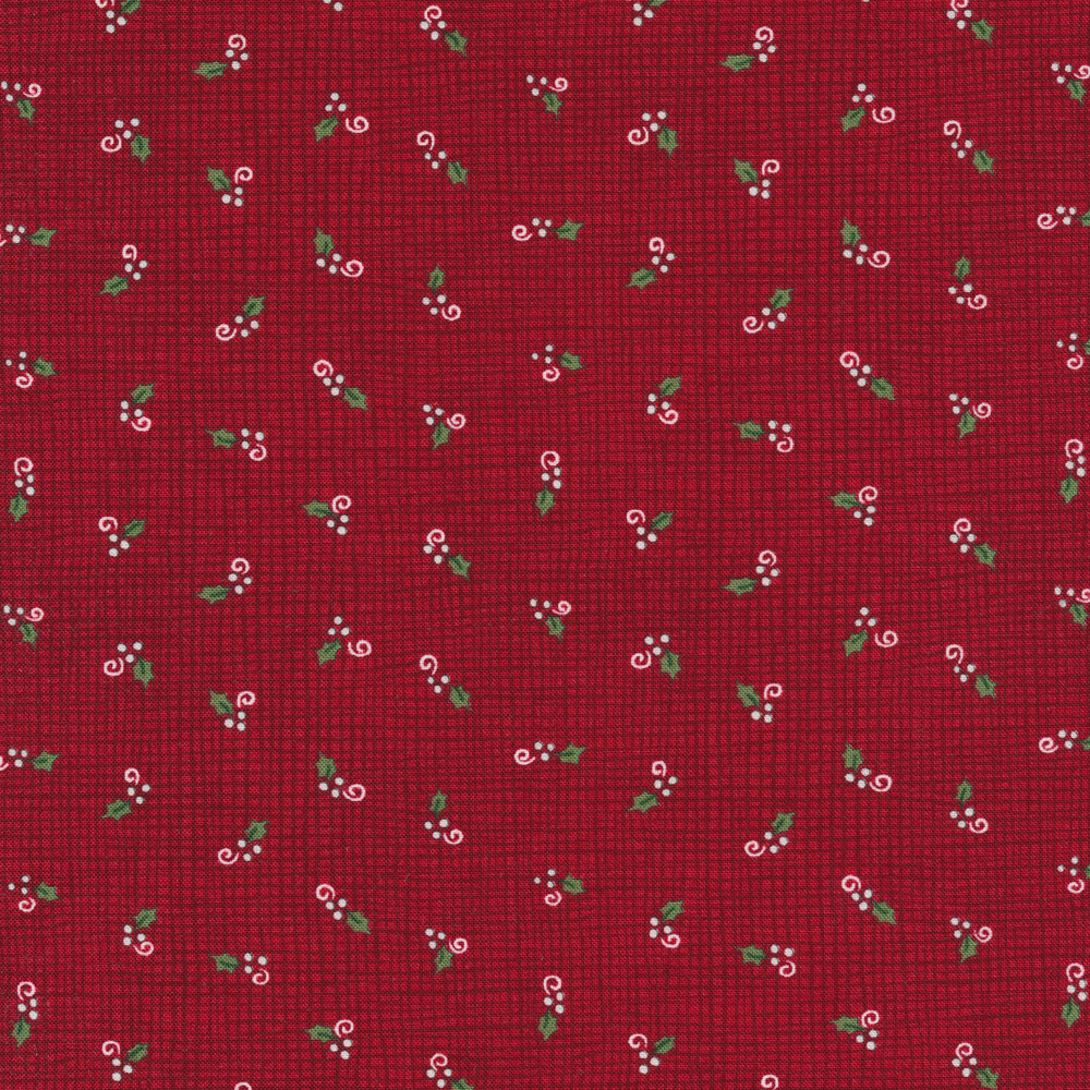 Tossed holly berries on a red burlap texture background
