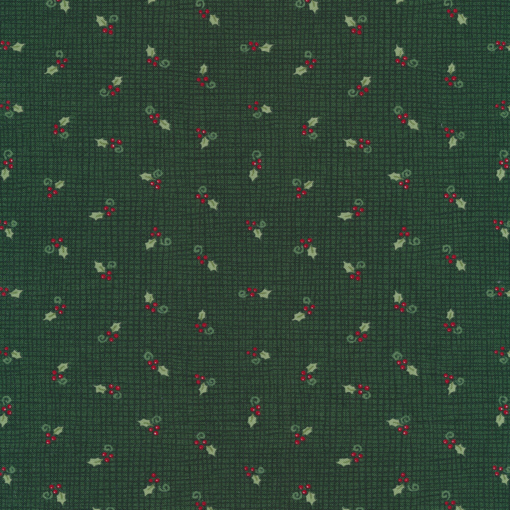 Tossed holly berries on a green burlap texture background