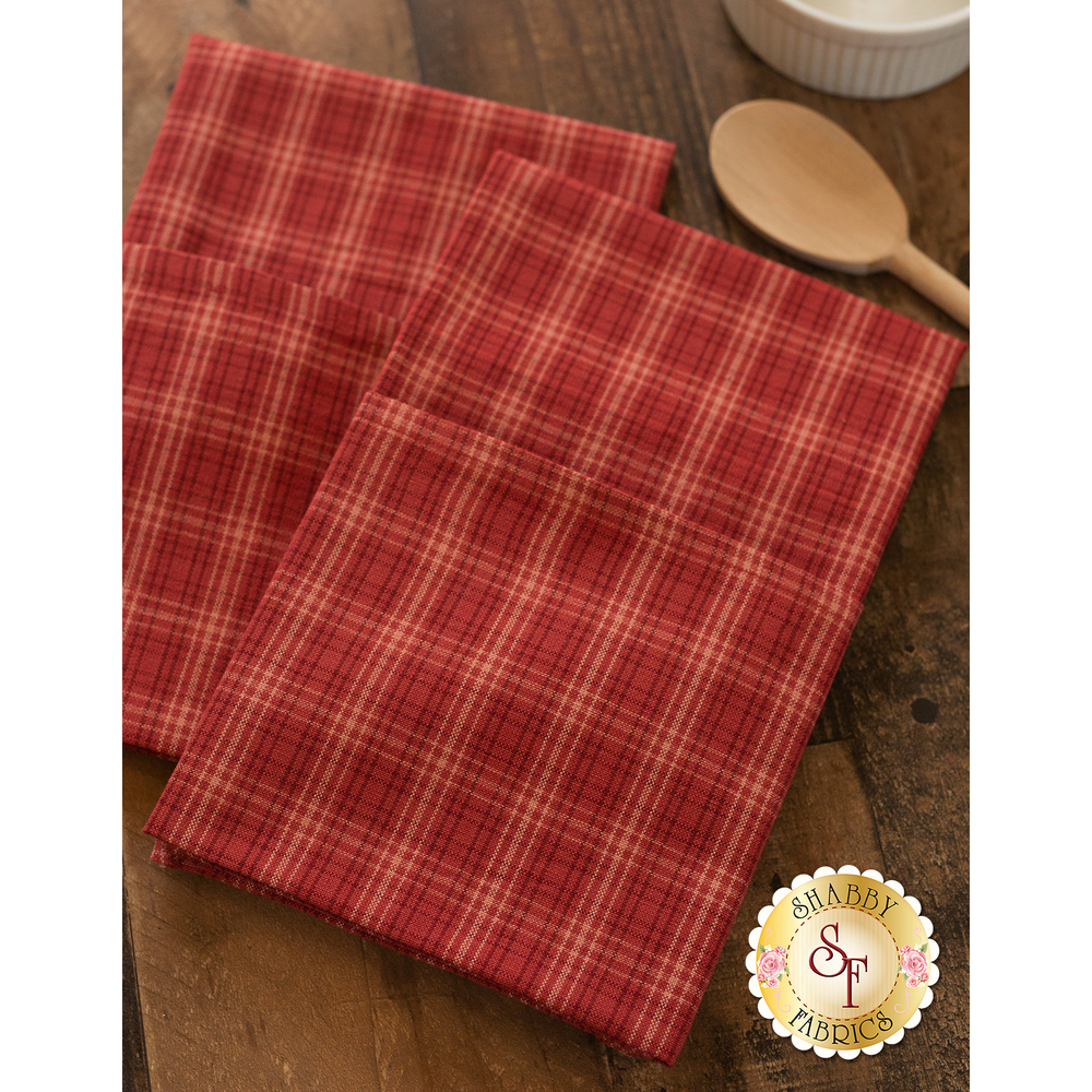 Red plaid towels displayed on table | Shabby Fabrics