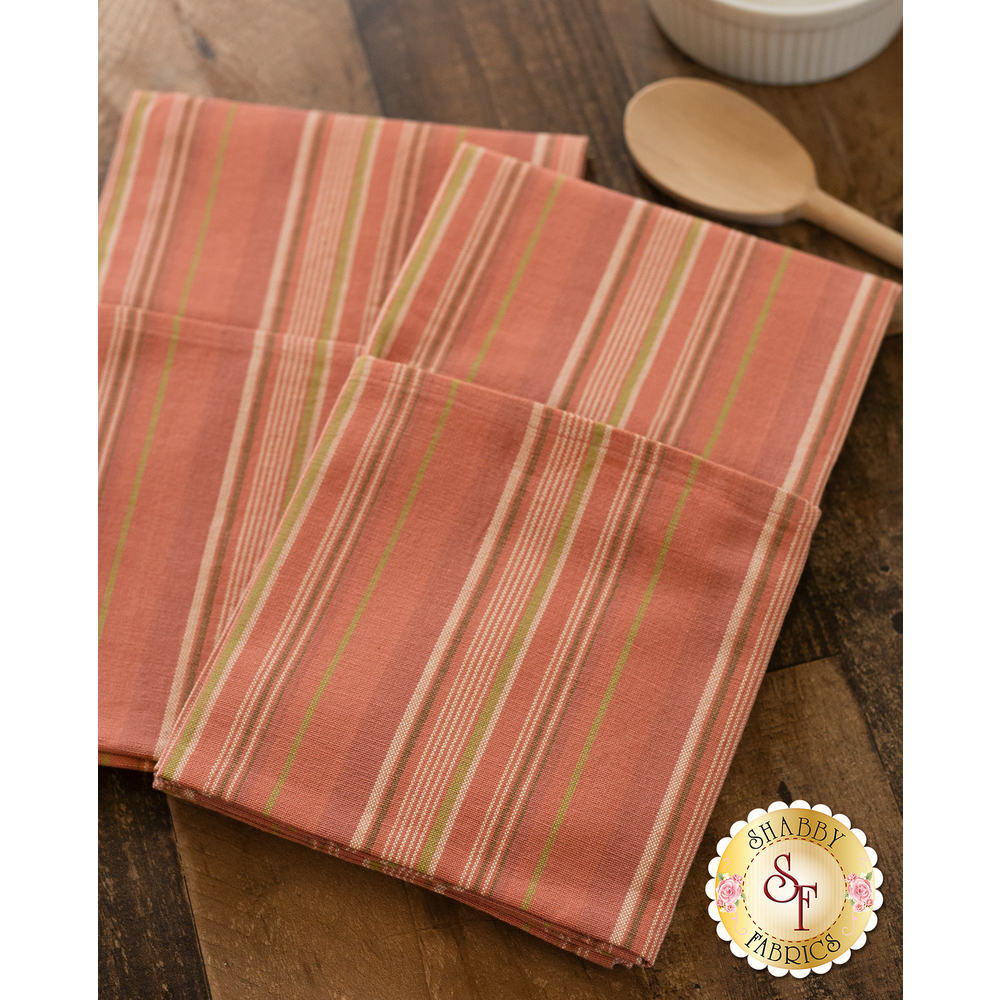 Pink towels displayed on table | Shabby Fabrics