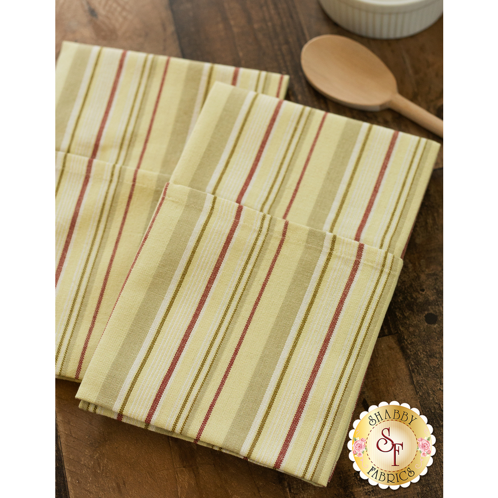 Yellow and red striped towels displayed on table | Shabby Fabrics