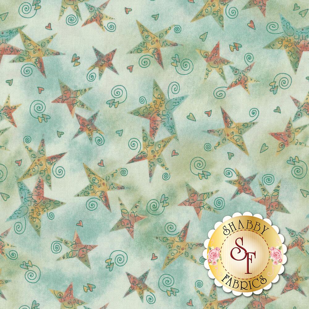 Tossed multi color stars on a mottled background | Shabby Fabrics