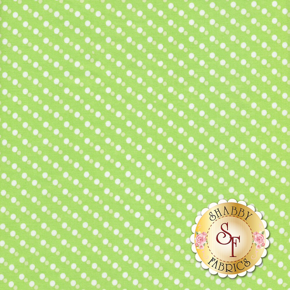White polka dots with smaller light green dots on a green background | Shabby Fabrics