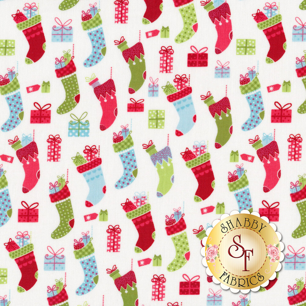 Multi colored stockings and Christmas presents on a white background | Shabby Fabrics