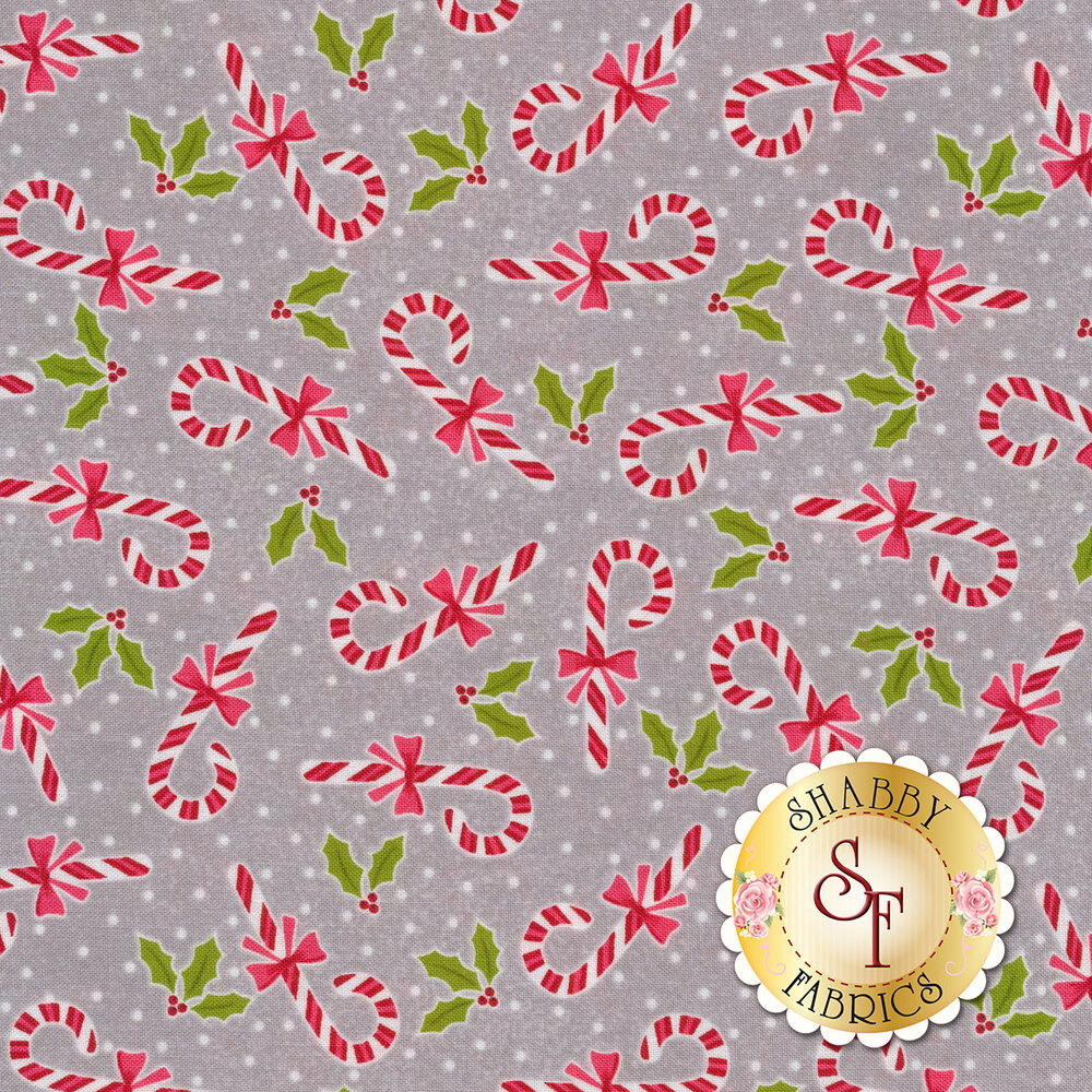 Tossed candy canes and holly on a grey background   Shabby Fabrics