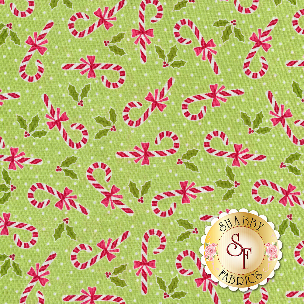 Tossed candy canes and holly on a green background   Shabby Fabrics