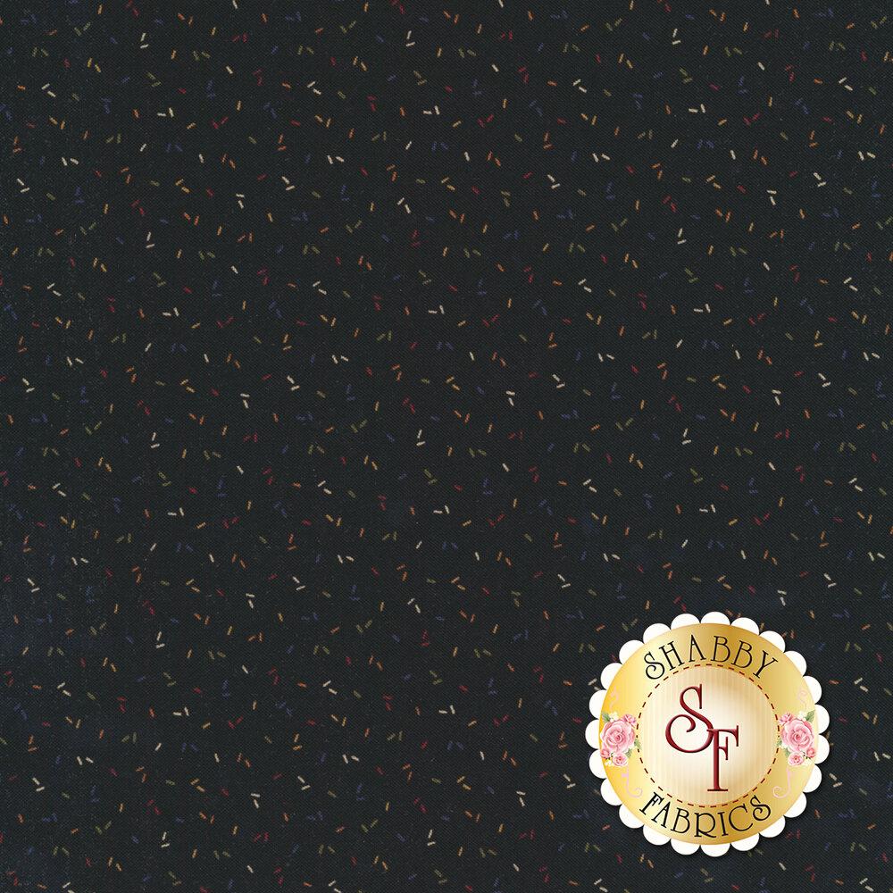 Multi colored confetti on a black background   Shabby Fabrics