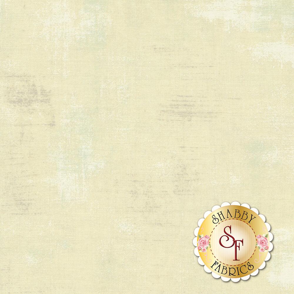 A distressed cream textured fabric   Shabby Fabrics