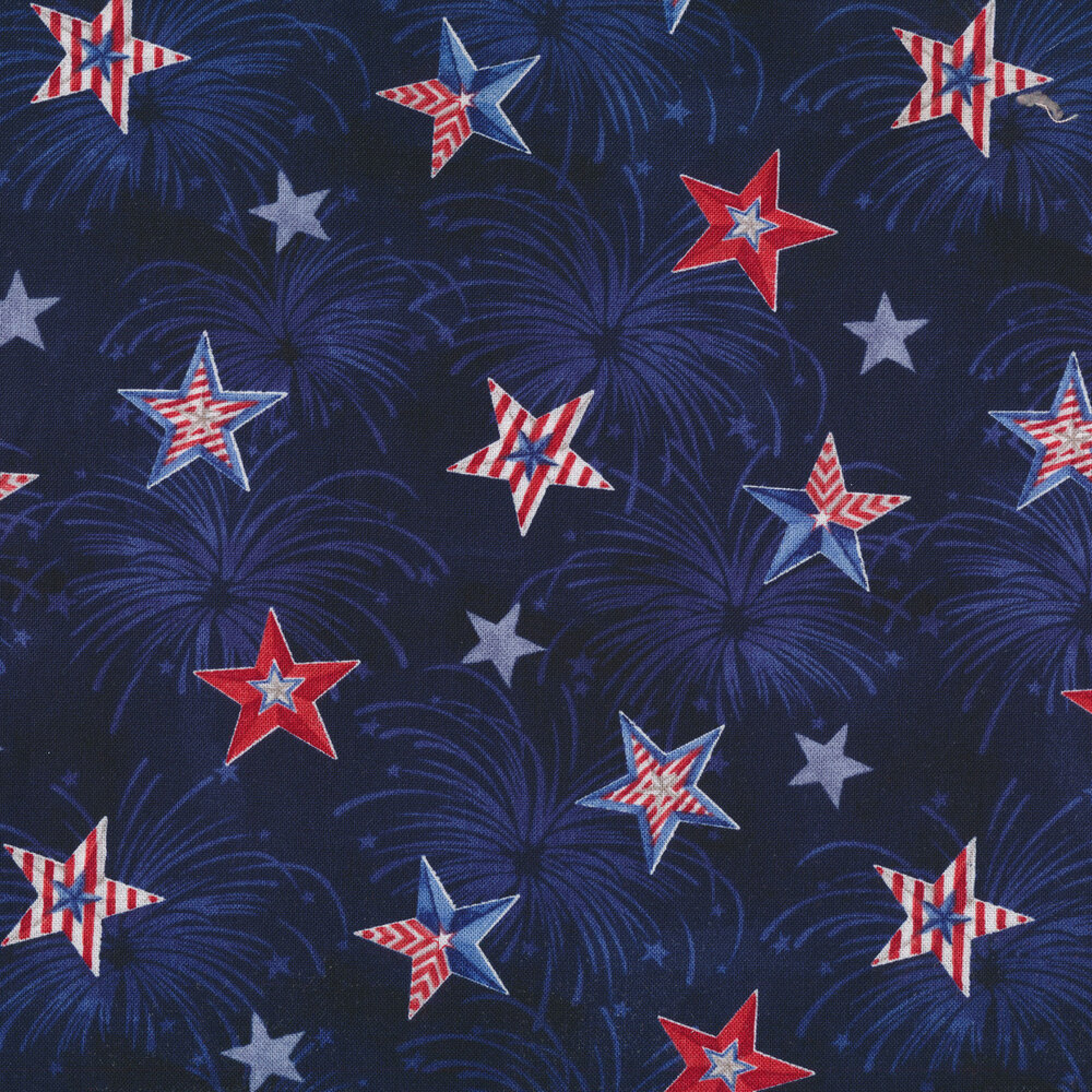 Tonal dark blue fireworks on a mottled navy background with red, white, and blue stars all over
