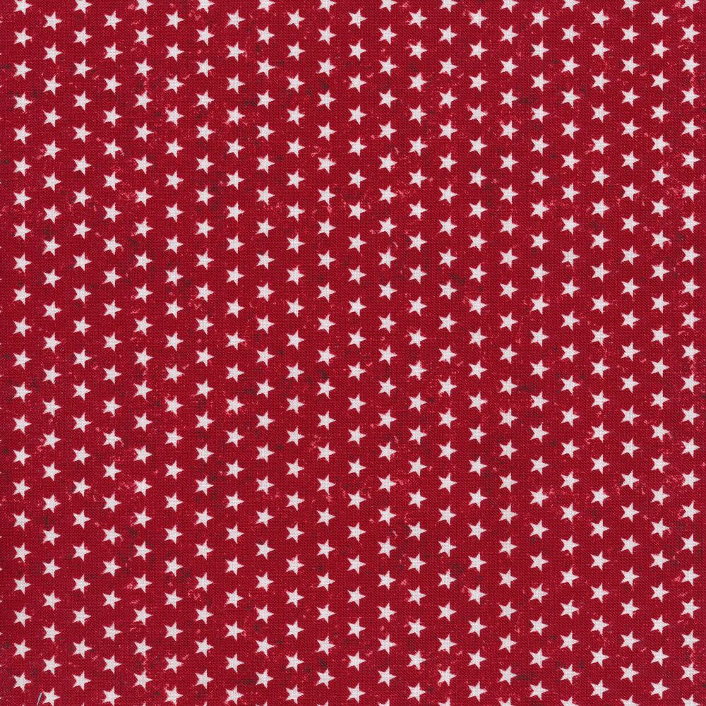 Small white stars on a red textured background