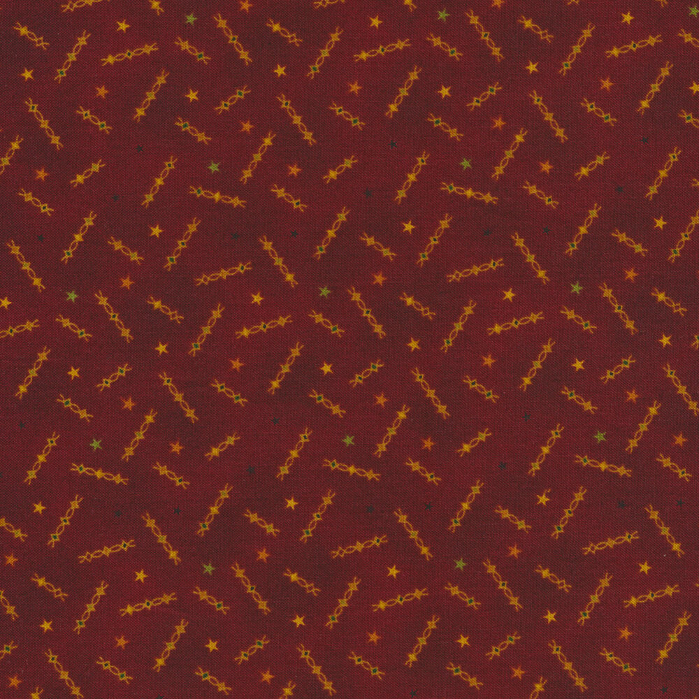 Yellow/gold squiggles and stars all over red | Shabby Fabrics