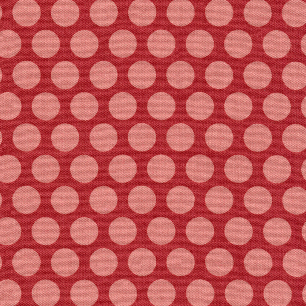 Pink polka dots on a red background
