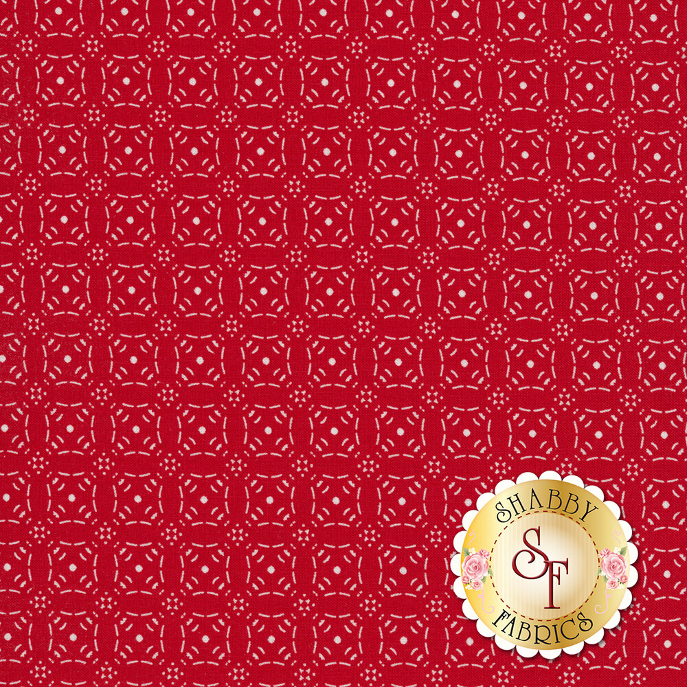 Red fabric with rows of white medallions   Shabby Fabrics
