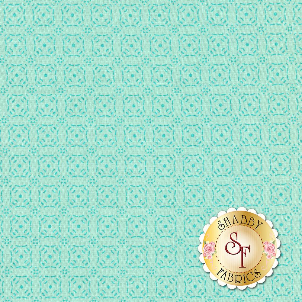 Tonal aqua fabric with rows of dark teal medallions | Shabby Fabrics