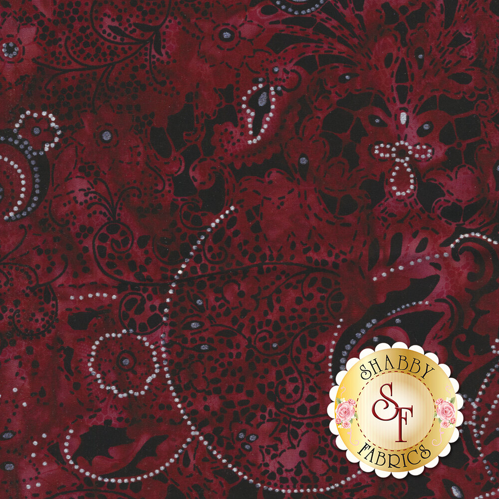 Dark red mottled batik with paisley and floral designs on black | Shabby Fabrics