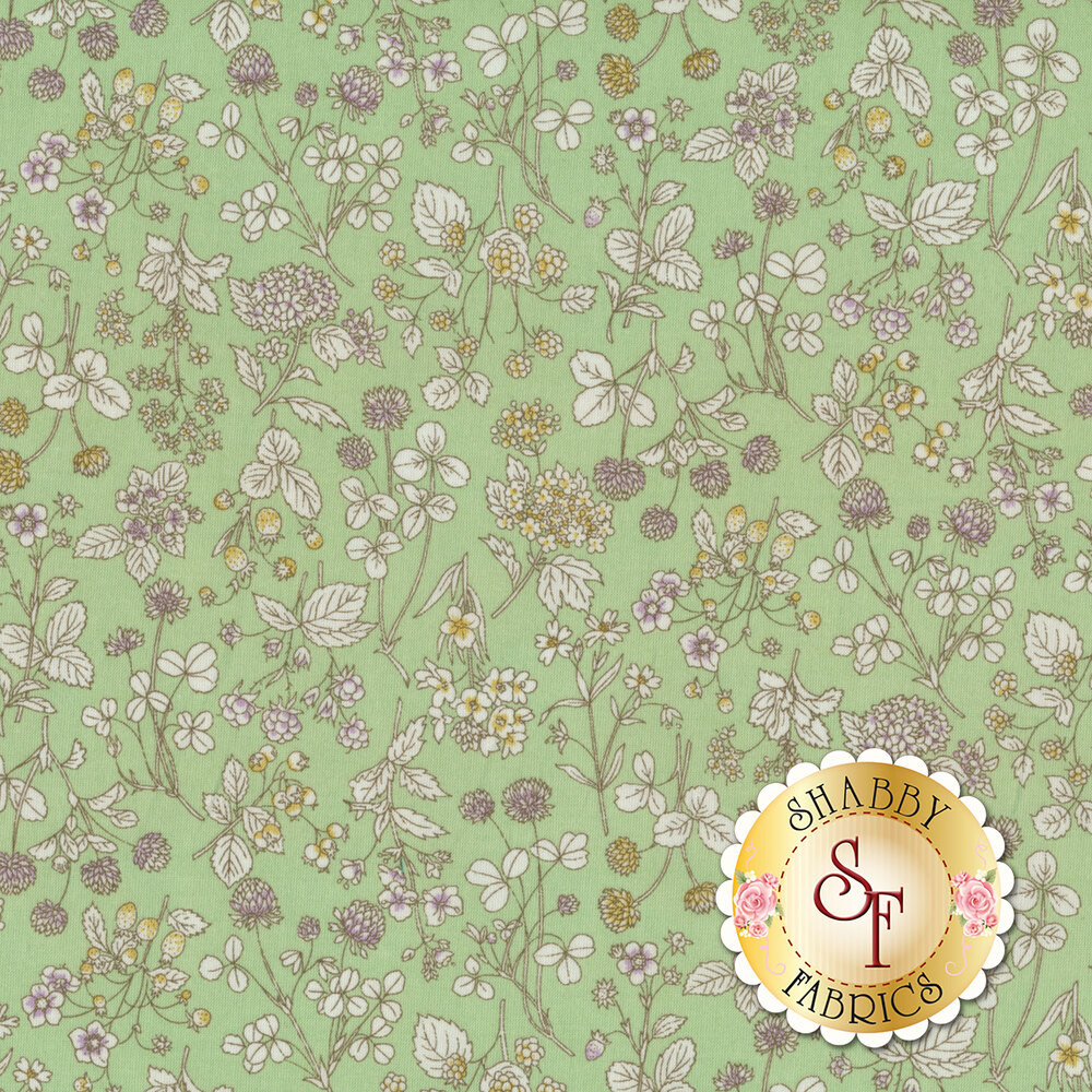 Fabric featuring an assortment of tossed flowers on a mint green background | Shabby Fabrics