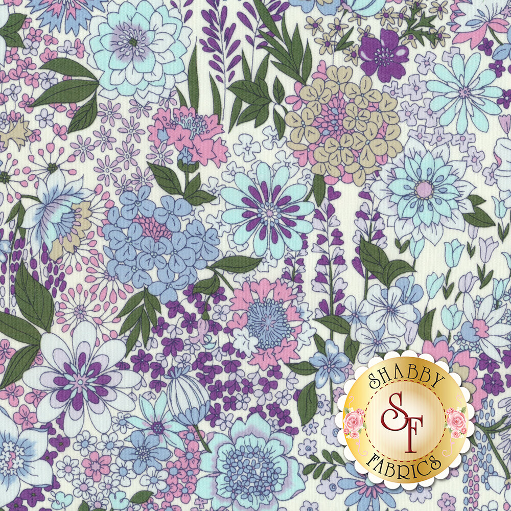 Fabric featuring bold multi colored flowers on a white background | Shabby Fabrics