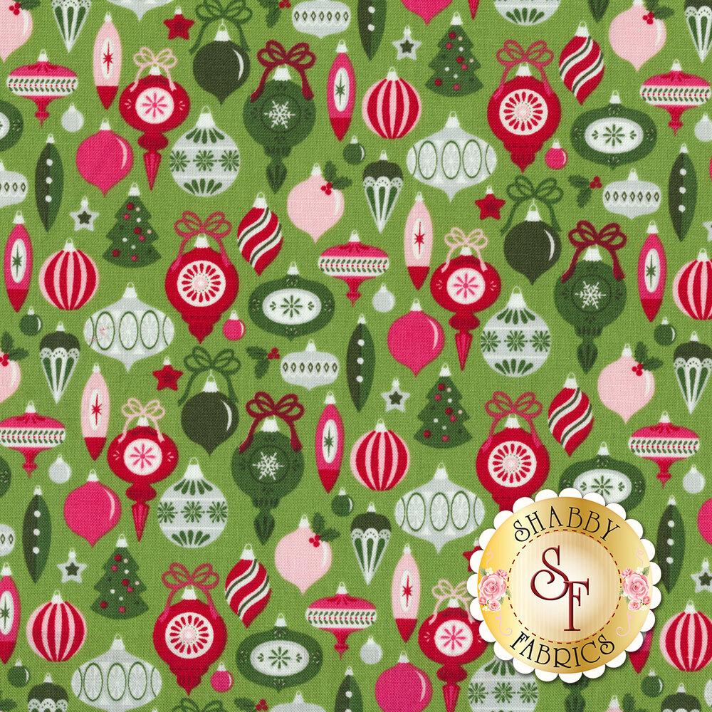 Multicolored Christmas ornaments on green   Shabby Fabrics