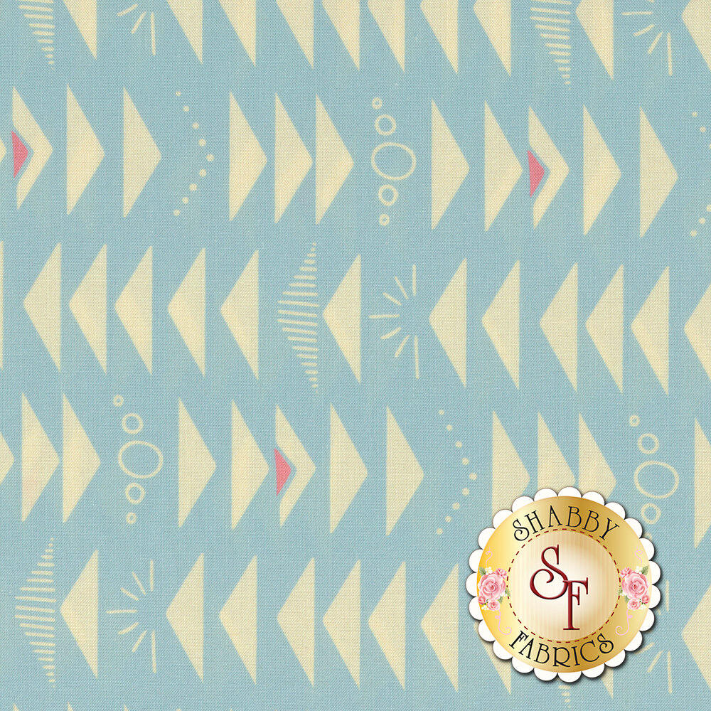 Alternating yellow triangles, sunbursts, circles, and stripes on a light blue background