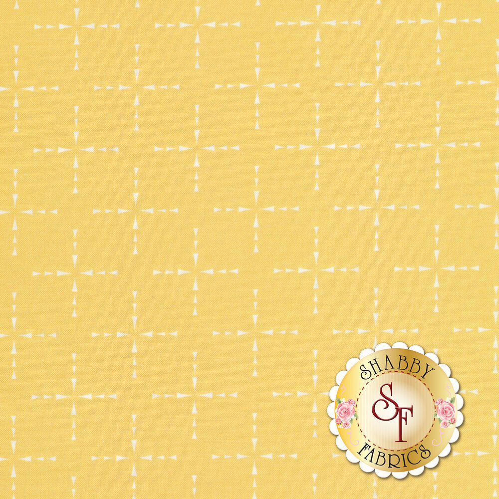 White arrows in the shape of crosses all over a yellow fabric | Shabby Fabrics