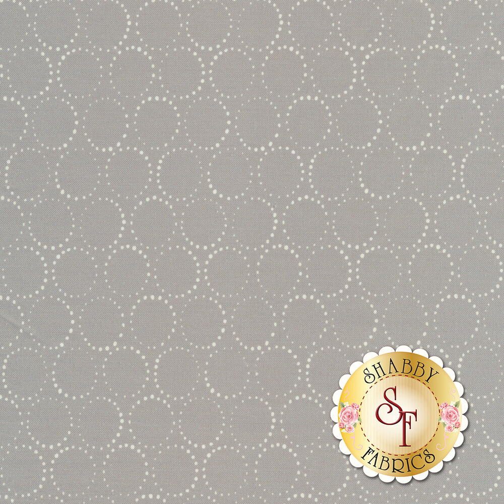Circular dots with larger dots pointing in different directions | Shabby Fabrics