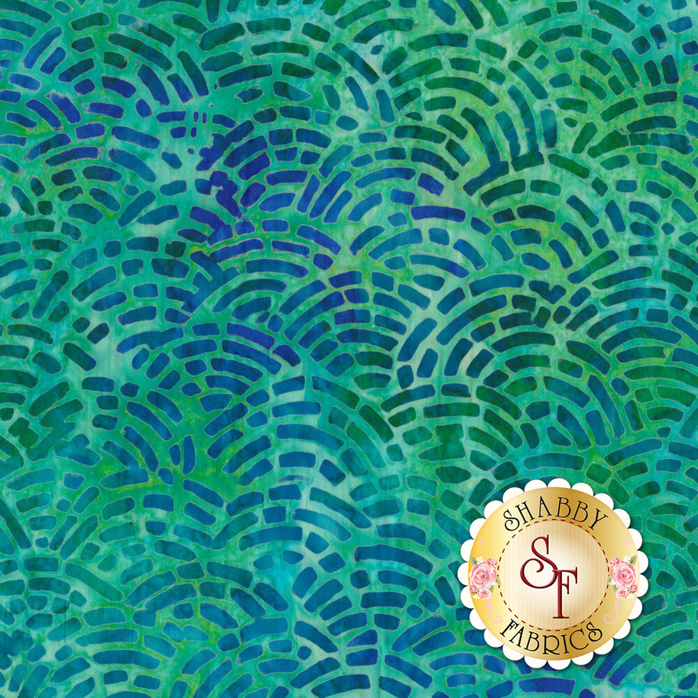 Green and blue mottled fabric with scalloped patterns