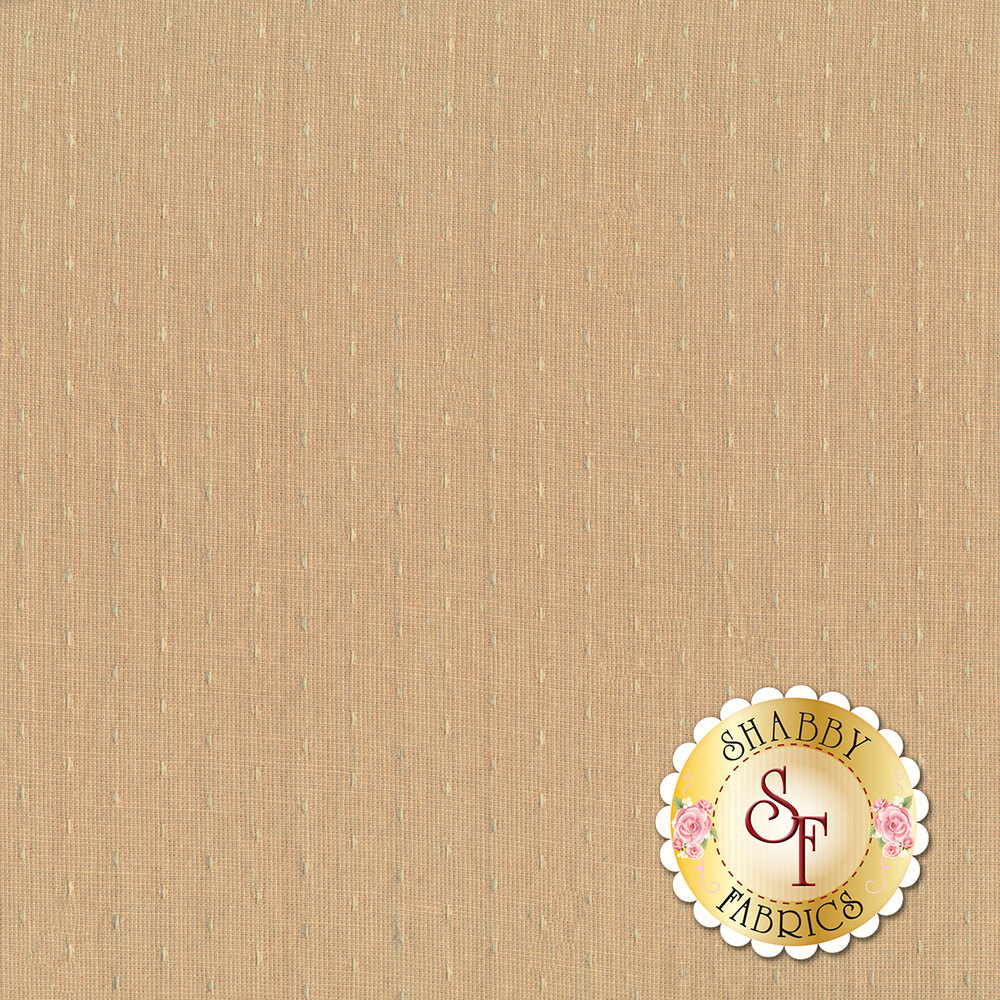 Woven dot pattern on dusty light brown/peach background | Shabby Fabrics