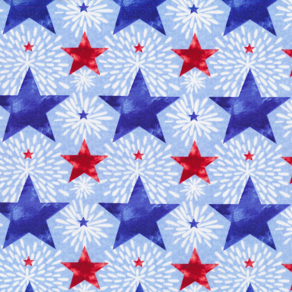 Red and blue stars and fireworks all over light blue | Shabby Fabrics
